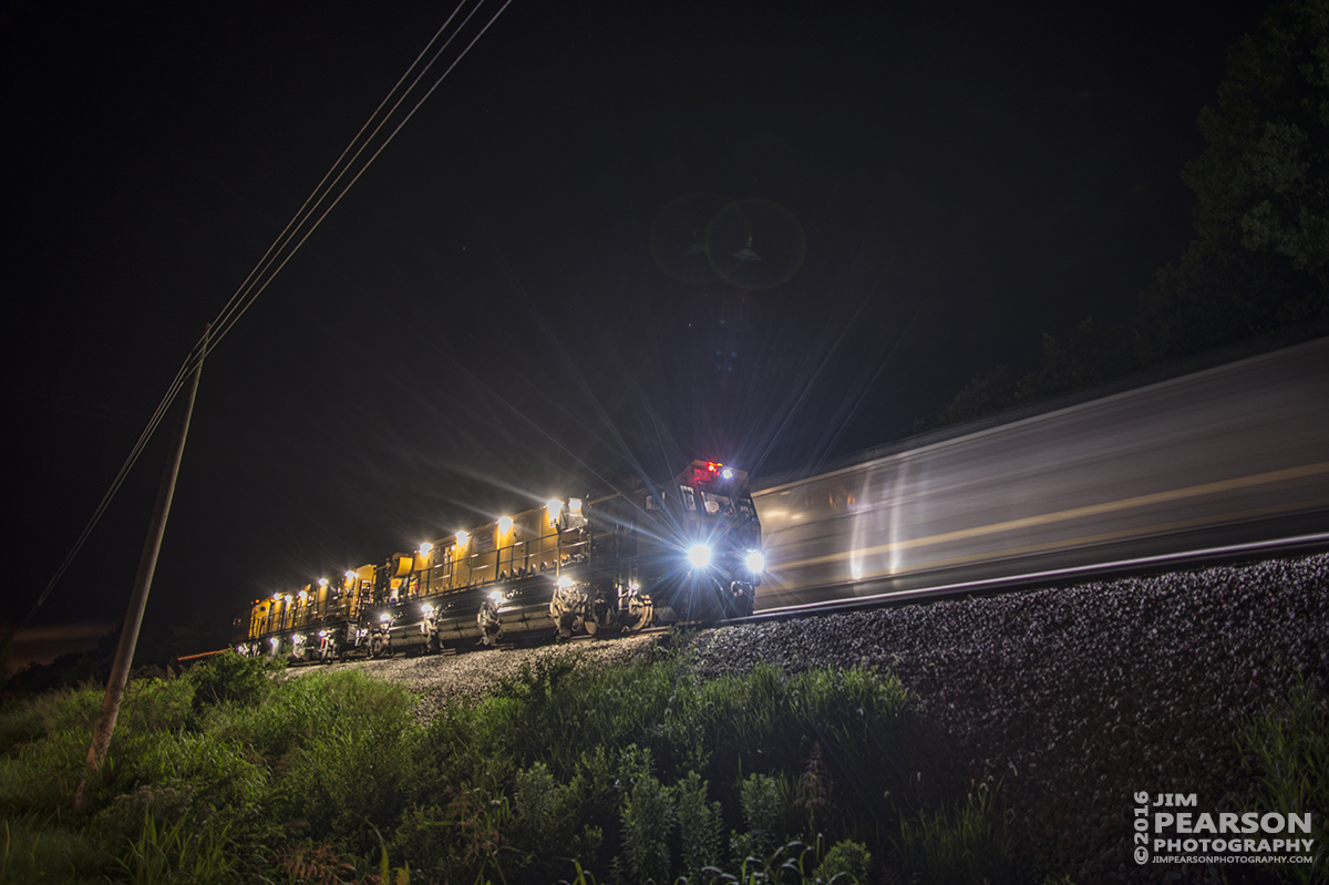 July 9, 2016 – LORAM Railgrinder RGS-9 waits in the siding at the north end of Robards, Ky as southbound loaded coal train CSX N040-05 passes it on CSX's Henderson Subdivision. - Tech Info: 3 seconds | f/2.8 | ISO 125 | Lens: Nikon 18mm with a Nikon D800 shot and processed in RAW.