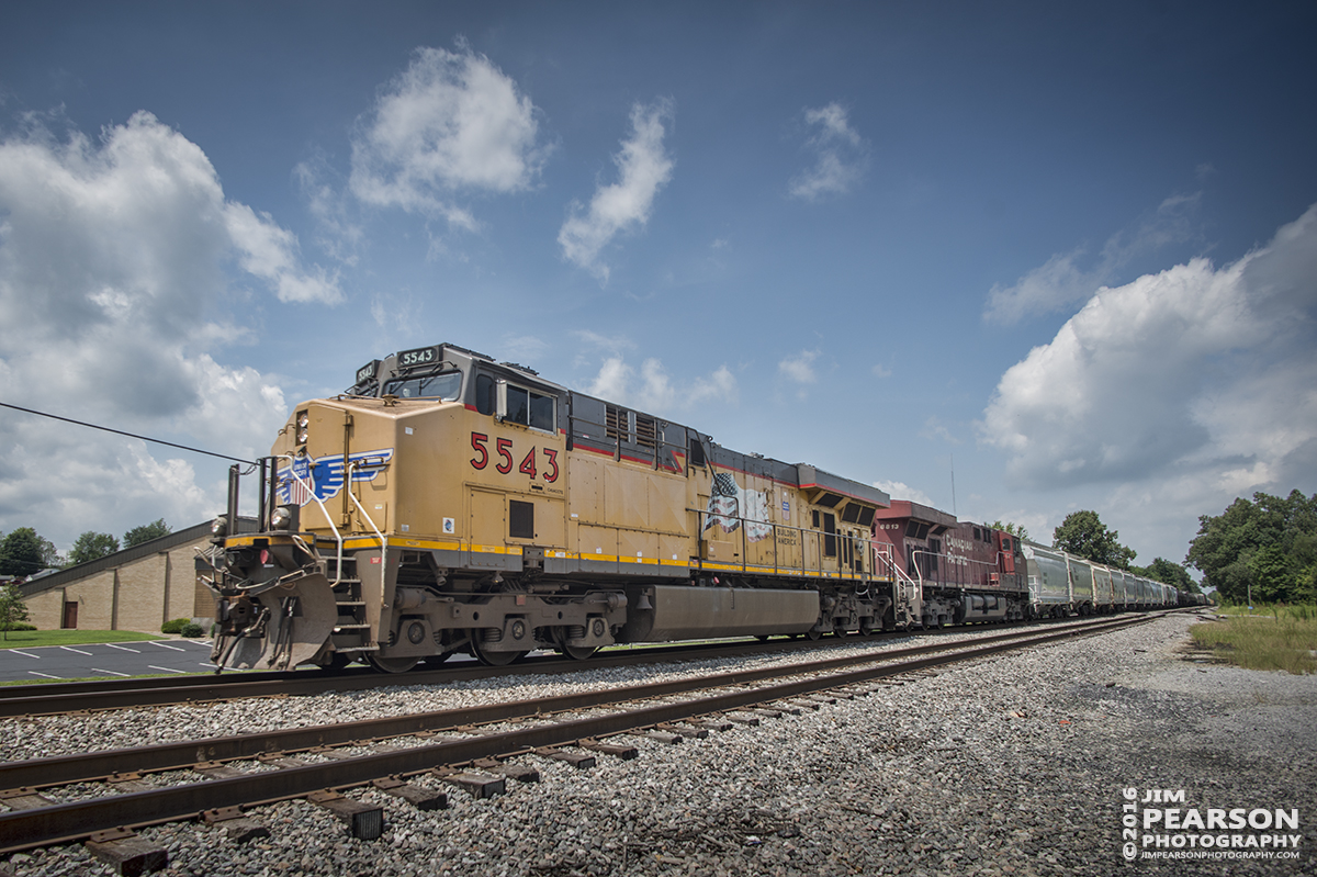 August 2, 2016 – CSX S515-02, (Indianapolis, IN - Nashville, TN) with Union Pacific 5543 leading and Canadian Pacific 8813 trailing, passes through Hanson, Ky with its 10,000 foot train as it heads south on the Henderson Subdivision. - Tech Info: 1/1000 | f/6.3 | ISO 160 | Lens: Nikon 18mm with a Nikon D800 shot and processed in RAW.