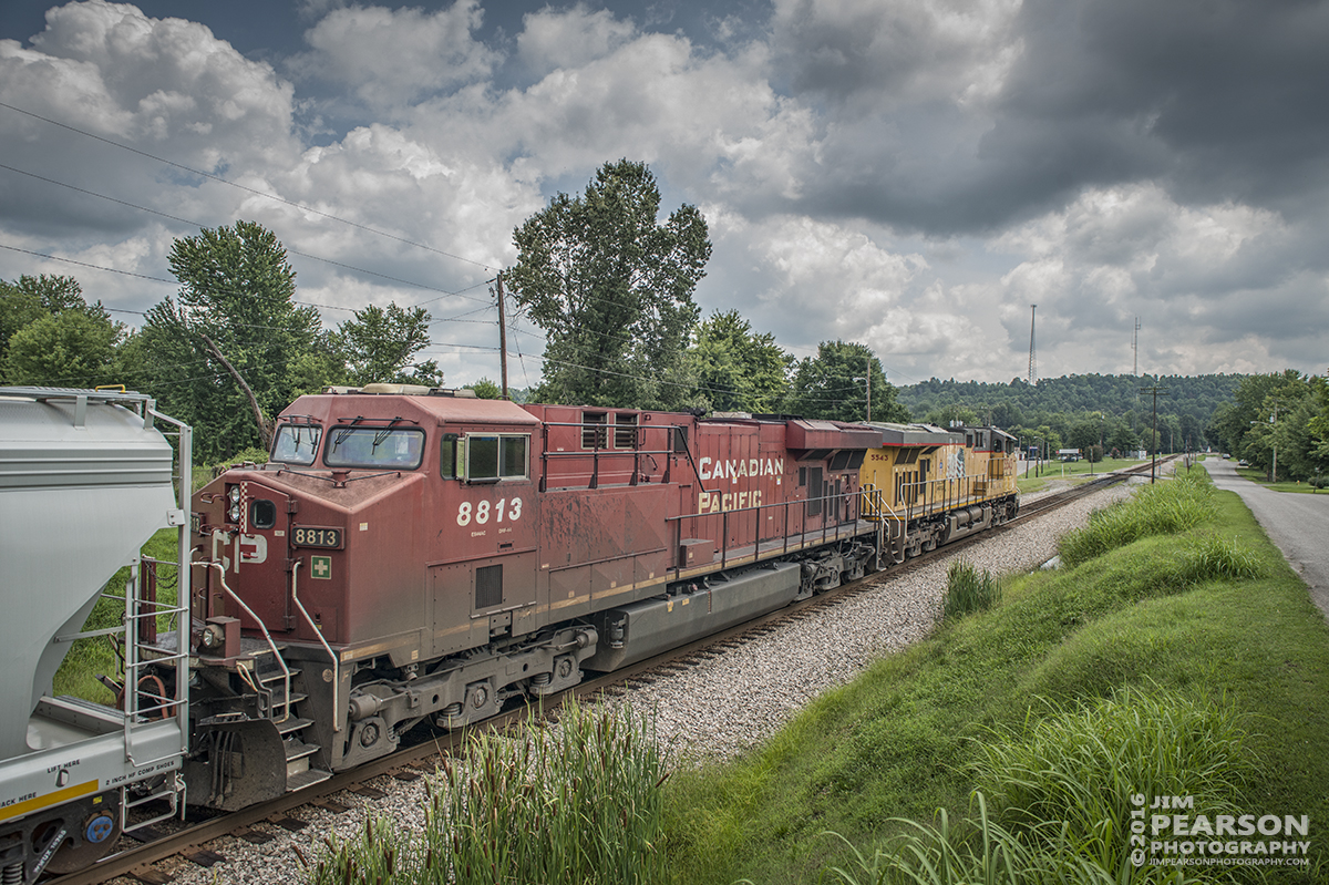 August 2, 2016 – CSX S515-02, (Indianapolis, IN - Nashville, TN) with Union Pacific 5543 leading and Canadian Pacific 8813 trailing, passes through Mortons Gap, Ky with its 10,000 foot train southbound on the Henderson Subdivision. - Tech Info: 1/1000 | f/6.3 | ISO 560 | Lens: Sigma 24-70 @ 24mm with a Nikon D800 shot and processed in RAW.
