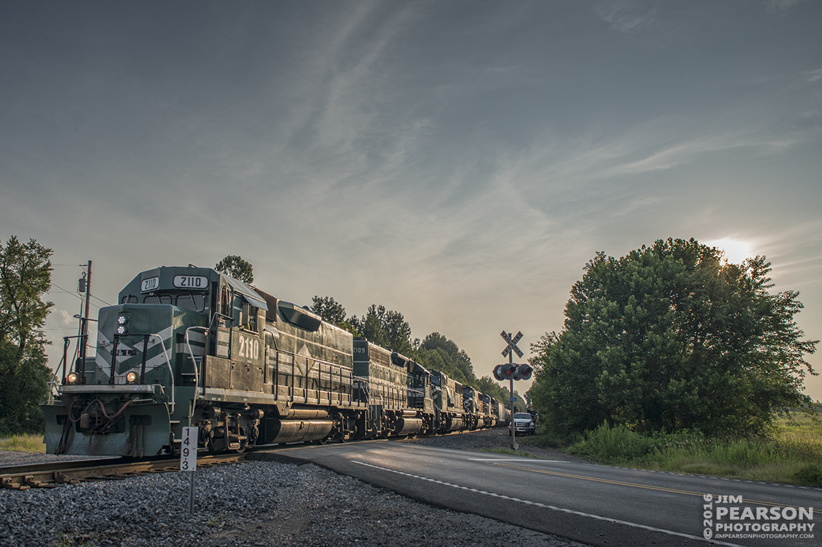 August 2, 2016 – Paducah and Louisville Railway's engine 2110 leads a local train north through the crossing at West Yard in Madisonville, Ky as the sun starts to set as it makes heads for CSX's Atkinson Yard on the Henderson Subdivision for interchange work. - Tech Info: 1/1000 | f/6.3 | ISO 200 | Lens: Sigma 24-70 @ 24mm with a Nikon D800 shot and processed in RAW.