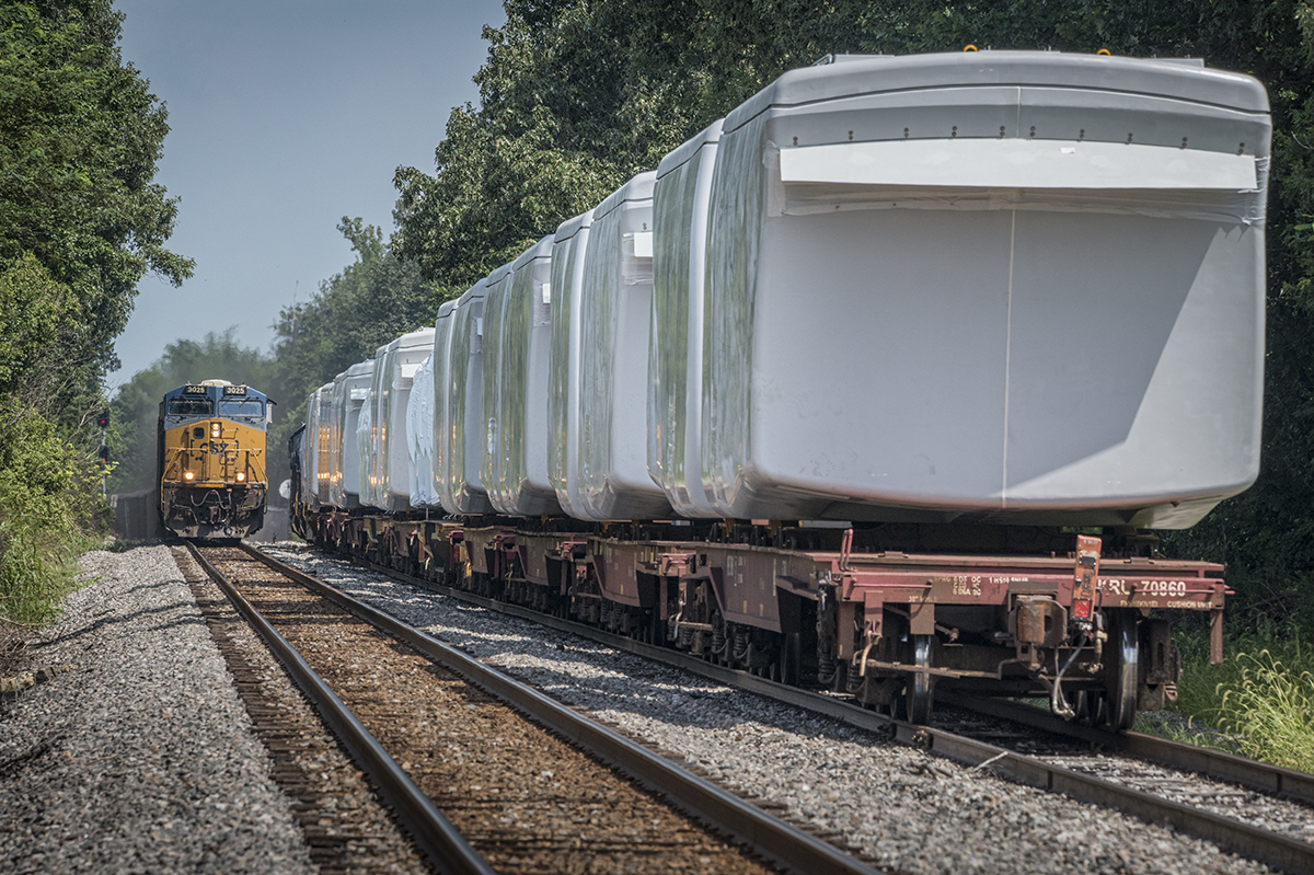 August 5, 2016 – Southbound CSX loaded coal train N320 (Evansville, IN (EVWR) - Cross, SC) meets W987-30 with a load of windmill motors waiting to go north from the north end of Hanson siding as N320 makes it's way south on the Henderson Subdivision at Hanson, Ky.