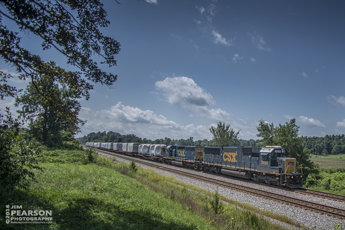 August 5, 2016 – CSX W987-30, with a load of wind turbine motors, heads north on the Henderson Subdivision at Slaughters, Ky with CSXT 2491 and 8367 as power. - Tech Info: 1/3200 | f/2.8 | ISO 125 | Lens: Nikon 18mm with a Nikon D800 shot and processed in RAW.