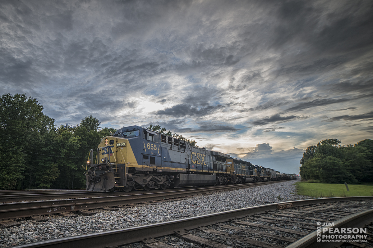 August 15, 2016 A CSX Q597 (Chicago, IL (BRC) - Nashville, TN) heads through Guthrie, Ky as light begins to fade as it heads south on the Henderson Subdivision.