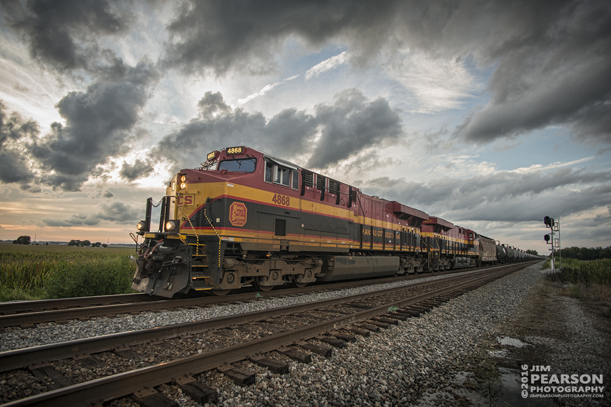 August 20, 2016 - CSX K443, with Kansas City Southern 4868 and 4830 leading the way, approach the crossing at County Road 550 at Middle King just outside of Ft. Branch, Indiana at dusk as it makes its way south with a loaded Ethanol Train on the CE&D Subdivision.
