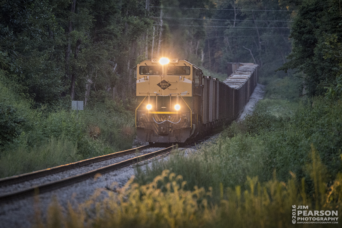 """August 22, 2016 - Norfolk Southern Heritage Unit 1067, """"Reading Lines"""" makes it's way up a slight grade on the Indiana Railroad as it approaches the connection at Sullivan, Indiana to CSX's CE&D Subdivision where it continued south to Oaktown, IN to pickup a load of coal."""