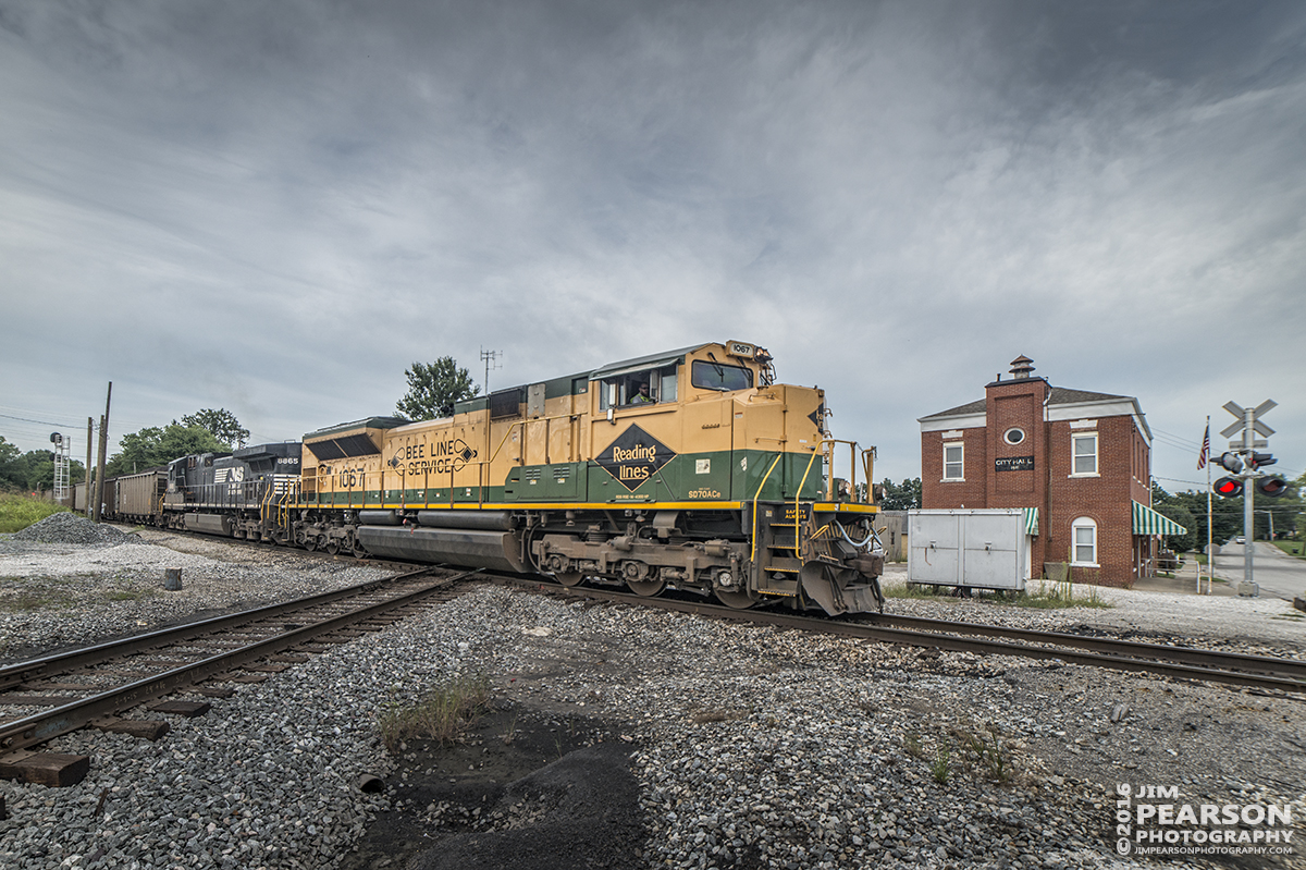 August 23, 2016 - Norfolk Southern, NS 1067 (EMD SD70ACe), the Reading Lines Heritage Unit, leads a loaded southbound Vectren coal train across NS line at the diamond on the Indiana Southern Railroad at Oakland City, Indiana.