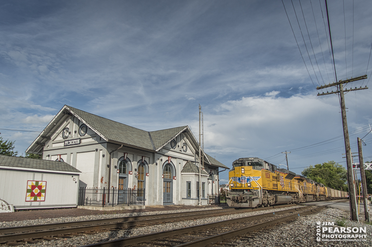August 20, 2016 - CSX E050-16 coal train approaches the station at Princeton, Indiana, with a set of Union Pacific engines leading the way, as it heads north on CSX's CE&D Subdivision. The depot was built in 1875 and has been beautifully restored and is the only remaining depot structure in Gibson County. It once housed the C&EI and L&N railways and is now home to the Gibson County Visitors Center and features a railway museum with a restored train caboose.