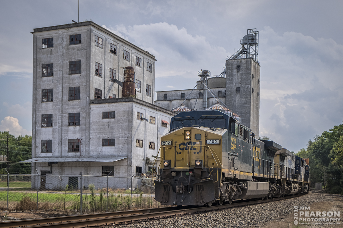 September 14, 2016 - CSX intermodal Q028-14 (Atlanta, GA - Chicago, IL) passes the old General Mills flour mill just off of 17th Street close to downtown Hopkinsville, Ky as it heads north on the Henderson Subdivision.