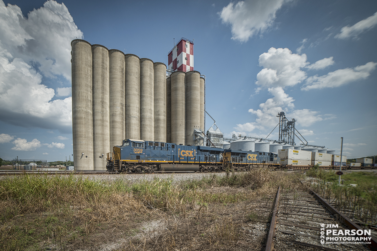 September 14, 2016 - CSX Q028 passes the grain silos at Hopkinsville Elevators on Skyline Drive in Hopkinsville, Ky as it heads north on the Henderson Subdivision.