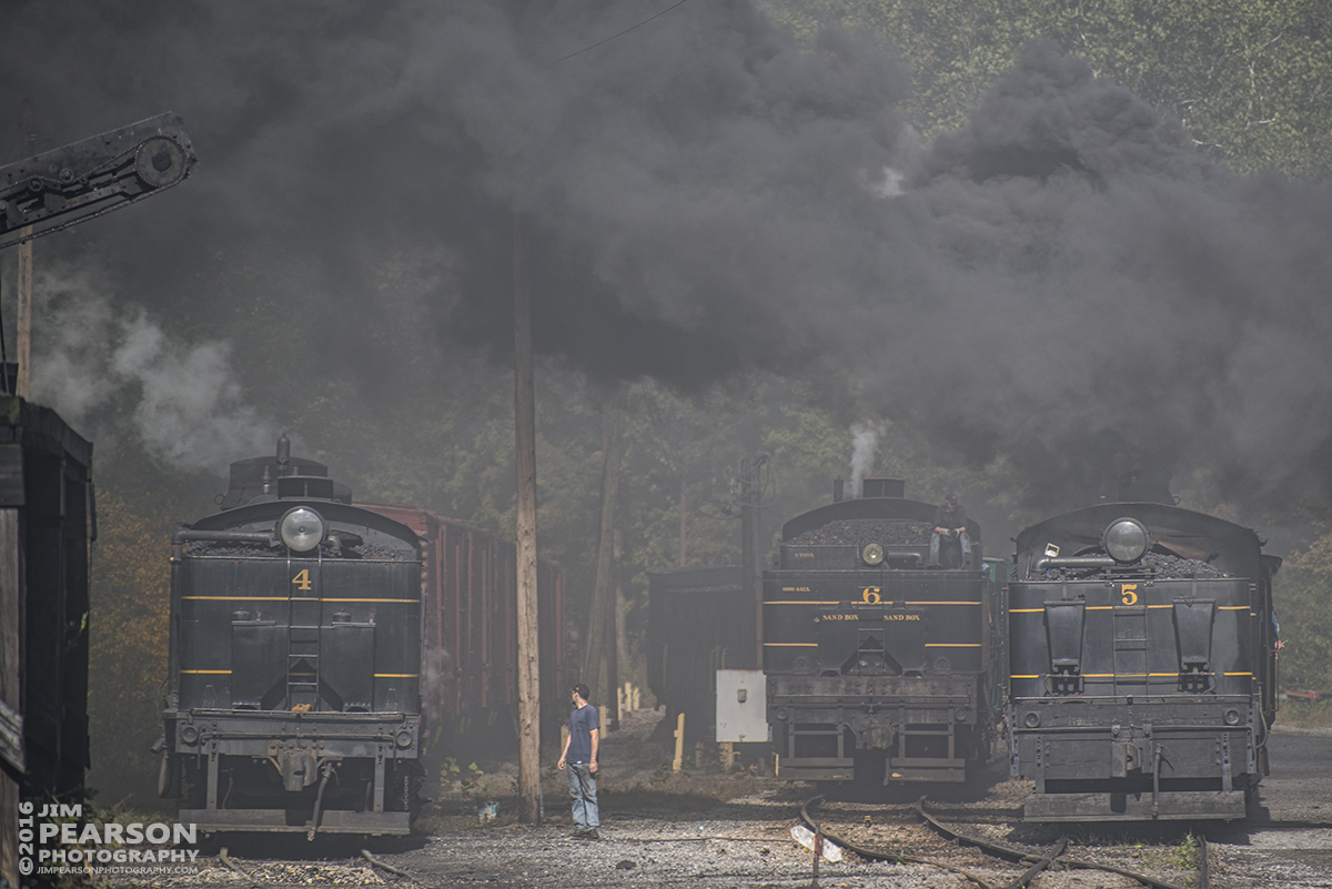 October 1, 2016 - Cass Scenic Railroad Shay Locomotives 4, and 6, wait in the siding as #5, the first passenger train of the day, makes it's way through the yard with a loaded passenger train at Cass, West Virginia. Locomotives 4 and 6 were used later in the morning to double-head a train 30 minutes behind 5.