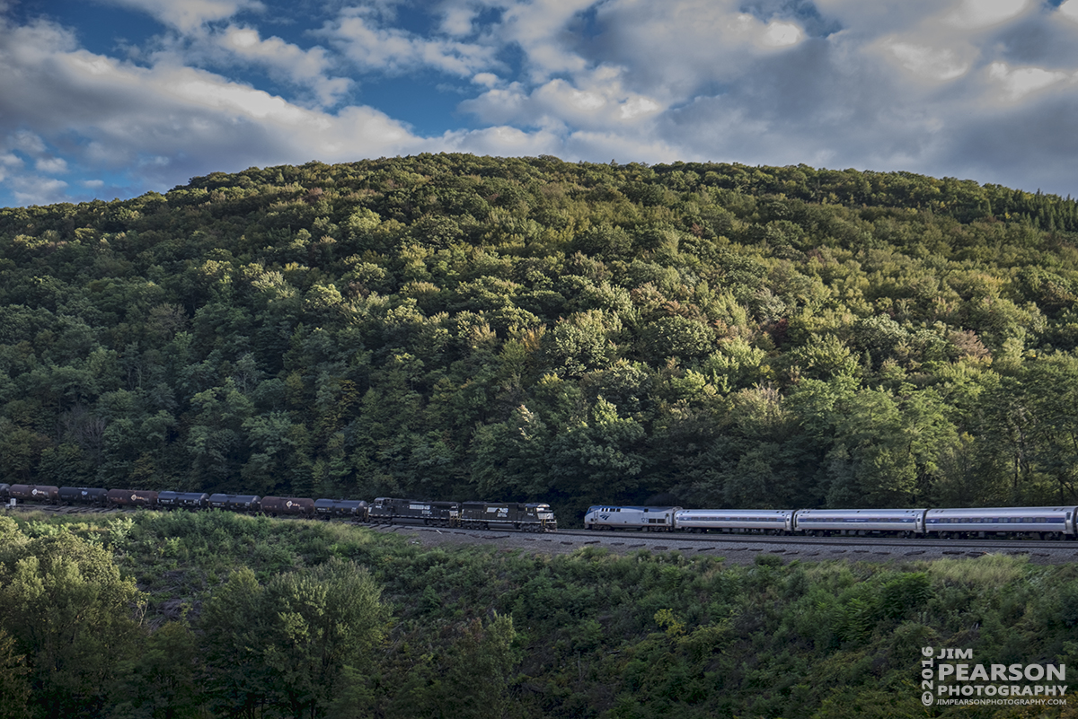 """October 2, 2016 - Westbound Amtrak """"Pennsylvanian"""" meets Norfolk Southern's Mixed Freight 16N Westbound at Horseshoe Curve in Altoona, Pa."""