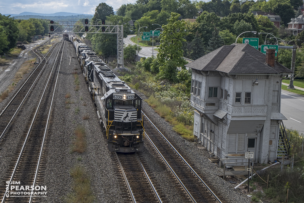October 2, 2016 - A westbound Norfolk Southern freight passes the Alto switch tower as it heads into Altoona, Pennsylvania.