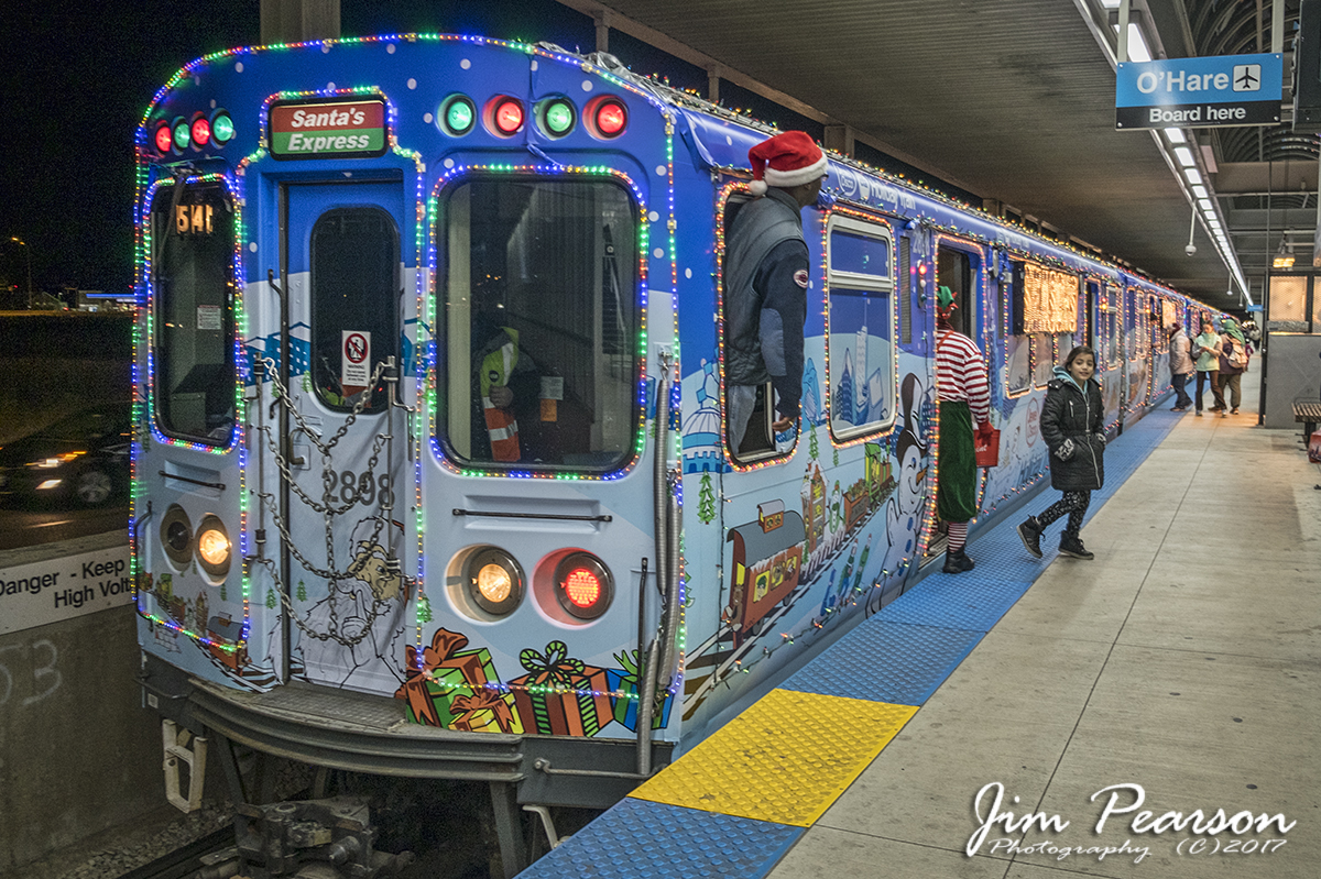 december 8 2017 the motorman and his elves on chicago transit authoritys cta holiday train santas express keep a watchful eye as passengers come - Cta Christmas Train 2014